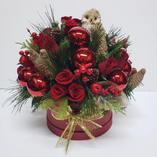 Caja de flores de navidad con búho de paja